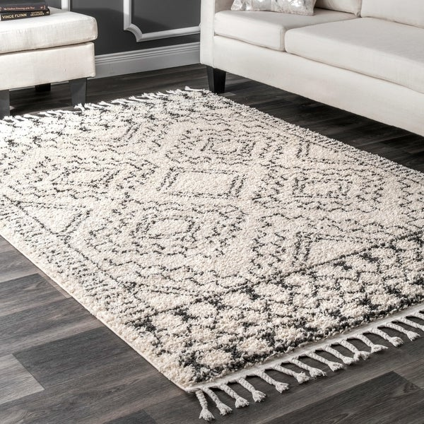 nuLOOM Soft and Plush Geometric Moroccan Shag Tassel Area Rug. Opens flyout.