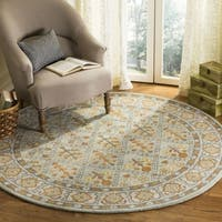 Safavieh Handmade Heritage Traditional Cream / Blue Wool Rug (6' x 6' Round)
