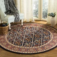 Safavieh Handmade Heritage Traditional Navy / Red Wool Rug (6' x 6' Round) - 6' x 6' Round