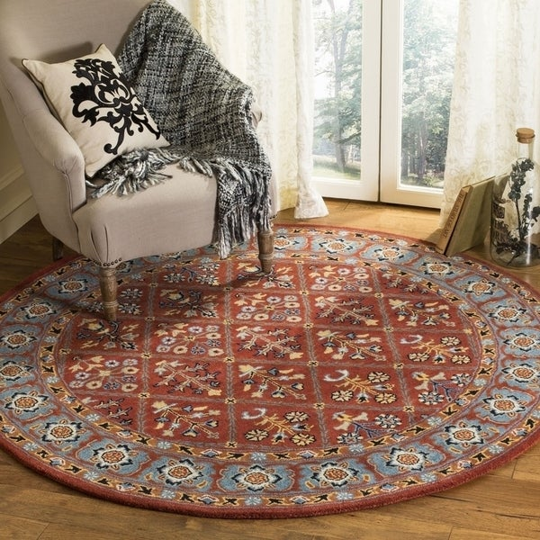 Safavieh Handmade Heritage Traditional Red / Blue Wool Rug (6' x 6' Round) - 6' x 6' Round