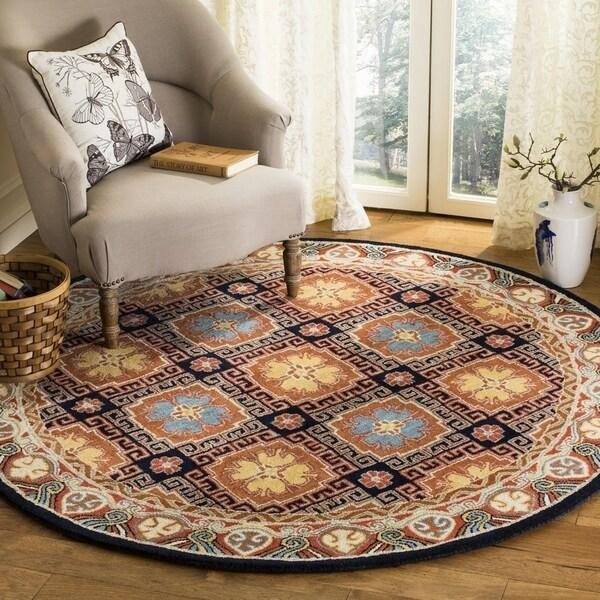 Safavieh Handmade Heritage Traditional Navy / Orange Wool Rug (6' x 6' Round) - 6' x 6' Round