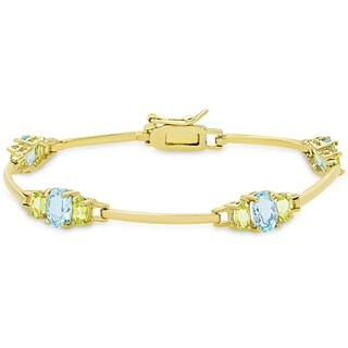 Dolce Giavonna Gold over Silver Blue Topaz and Peridot Bracelet