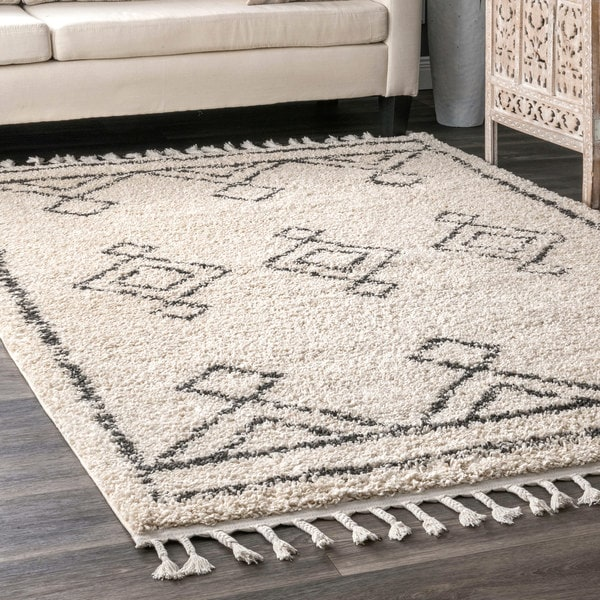 The Curated Nomad Prescott Moroccan Diamond Tassel Shag Rug. Opens flyout.