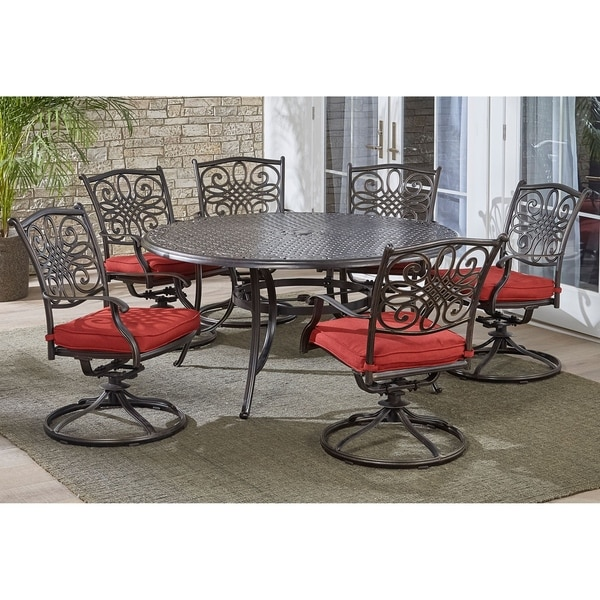 Hanover Traditions 7-Piece Dining Set in Red with a 60 In. Round Cast-top Table and Six Swivel Rockers