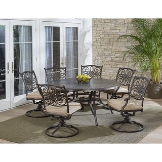 Hanover Traditions 7-Piece Dining Set in Tan with a 60 In. Round Cast-top Table and Six Swivel Rockers