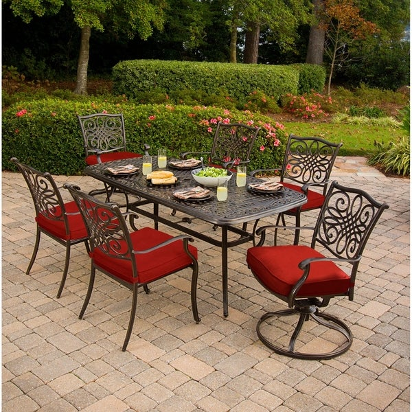 Hanover Traditions 7-Piece Dining Set in Red with Two Swivel Rockers, Four Dining Chairs, and a 72 x 38 in. Cast-top Table