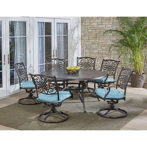 Hanover Traditions 7-Piece Dining Set in Blue with a 60 In. Round Cast-top Table and Six Swivel Rockers