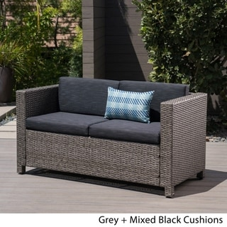 Link to Puerta Outdoor Wicker Loveseat with Cushion by Christopher Knight Home Similar Items in Outdoor Sofas, Chairs & Sectionals