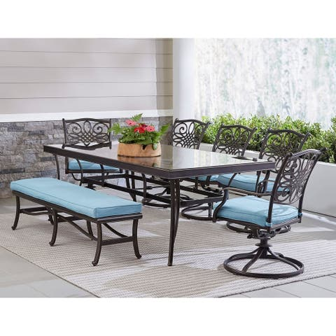 """Hanover Traditions 7-Piece Outdoor Dining Set in Blue with 5 Swivel Rockers, a Cushioned Bench, and a 42"""" x 84"""" Glass-Top Table"""