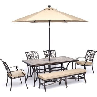 "Hanover Monaco 6-Piece Dining Set in Tan with 4 Arm Chairs, 1 Bench, a 40"" x 68"" Tile-Top Table, and a 9 Ft. Umbrella with Stand"