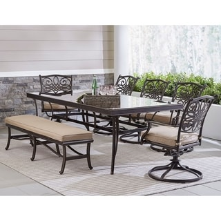 "Hanover Traditions 7-Piece Outdoor Dining Set in Tan with 5 Swivel Rockers, a Cushioned Bench, and a 42"" x 84"" Glass-Top Table"