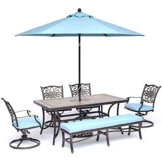 Hanover Monaco 6-Piece Dining Set in Blue with Swivel Rockers, Bench, Tile-Top Table, and Umbrella with Stand