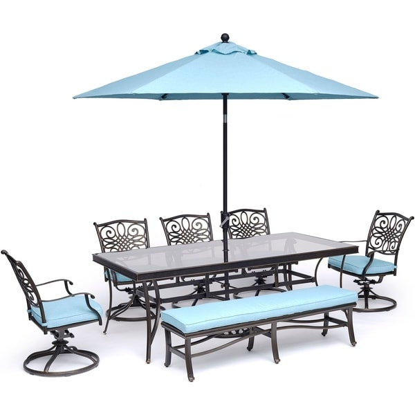 Hanover Traditions 7-Piece Dining Set in Blue with Swivel Rockers, Bench, Glass-Top Table, and Umbrella with Stand