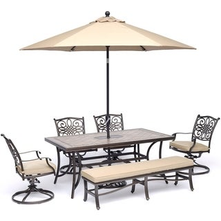 Hanover Monaco 6-Piece Dining Set in Tan with Swivel Rockers, Bench, Tile-Top Table, and Umbrella with Stand