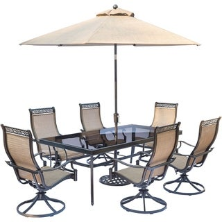 Hanover Monaco 7-Piece Dining Set with Sling Swivel Rockers, Glass-Top Dining Table, and Umbrella with Stand