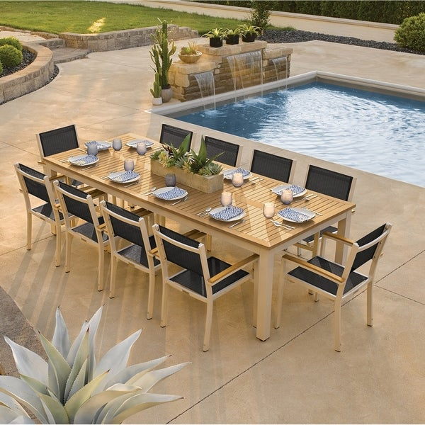 Oxford Garden Travira 11-piece 103-in x 42-in Tekwood Natural Table & Sling Armchair Dining Set - Ninja Sling. Opens flyout.