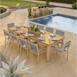Oxford Garden Travira 11-piece 103-in x 42-in Tekwood Natural Table & Sling Armchair Dining Set - Titanium Sling