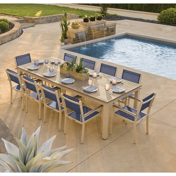 Oxford Garden Travira 11-piece 103-in x 42-in Tekwood Vintage Table & Sling Armchair Dining Set - Ink Sling. Opens flyout.