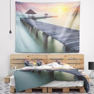 Designart 'Wooden Sea Bridge and Sunset' Seashore Photo Wall Tapestry