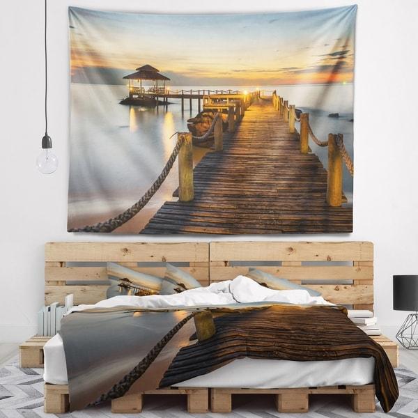 Designart 'Brown Wooden Pier in Evening' Seashore Photo Wall Tapestry