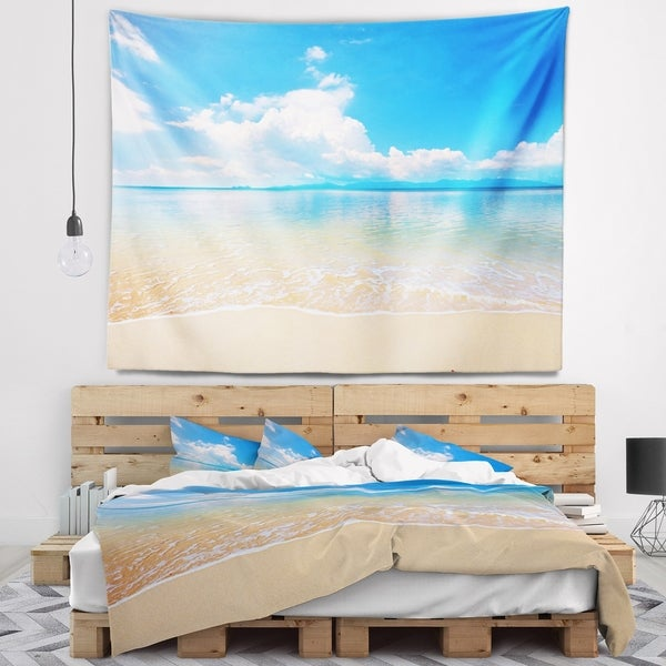 Designart 'Large Clouds Over Calm Beach' Seashore Photo Wall Tapestry