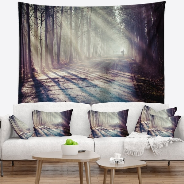 Designart 'Strong Sunbeams in Thick Forest' Landscape Photography Wall Tapestry