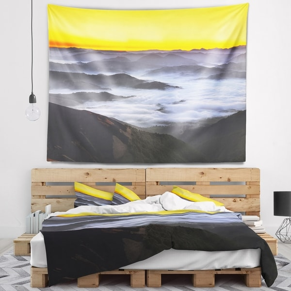 Designart 'Yellow Sky and Foggy Mountains' Landscape Wall Tapestry