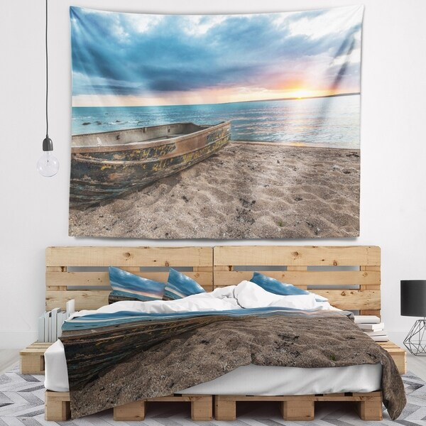 Designart 'Rusty Row Boat on Sand at Sunset' Seascape Wall Tapestry