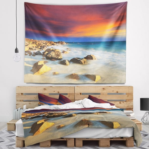 Designart 'Beach with Stones on Foreground' Seascape Wall Tapestry