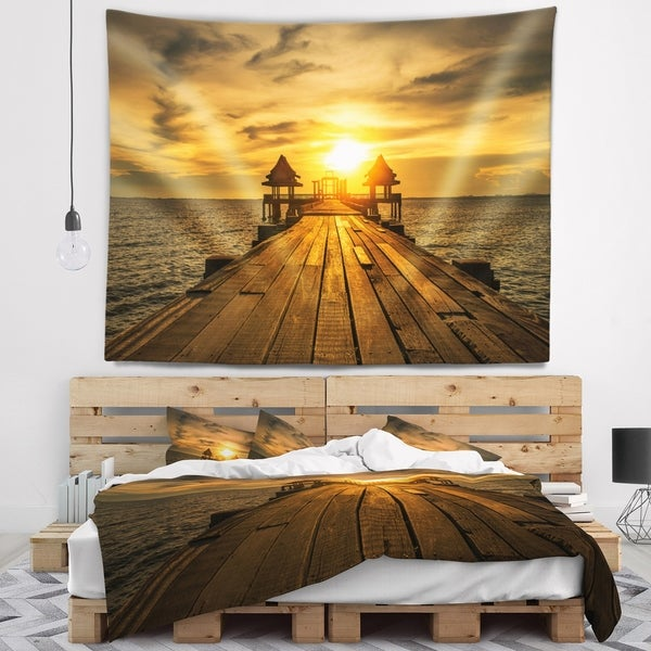 Designart 'Huge Wooden Bridge to Illuminated Sky' Pier Seascape Wall Tapestry