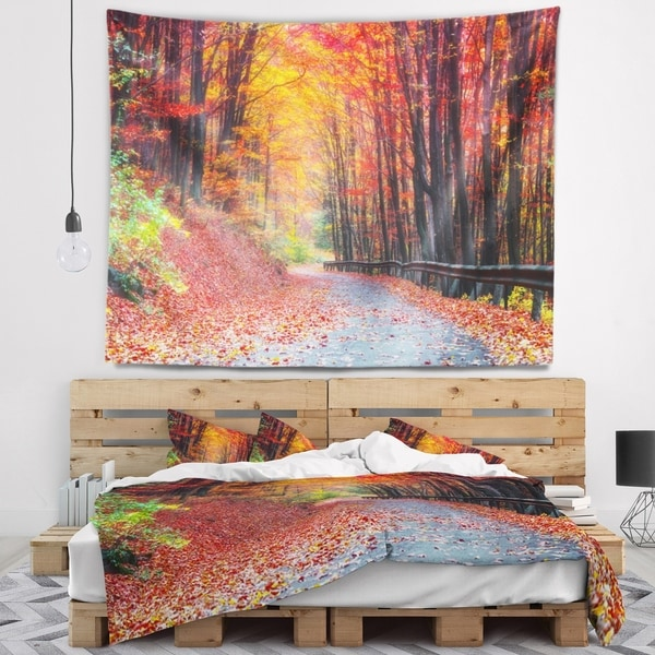 Designart 'Road in Beautiful Autumn Forest' Modern Forest Wall Tapestry