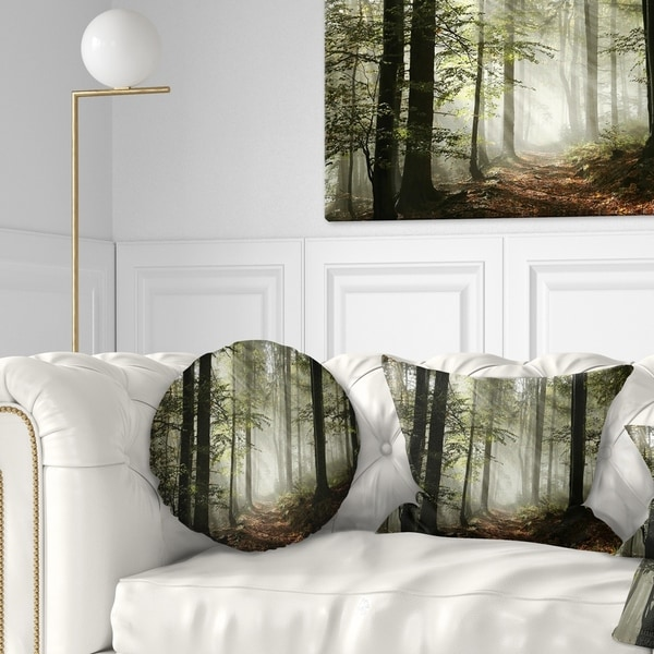 Designart 'Light in Dense Fall Forest with Fog' Landscape Printed Throw Pillow