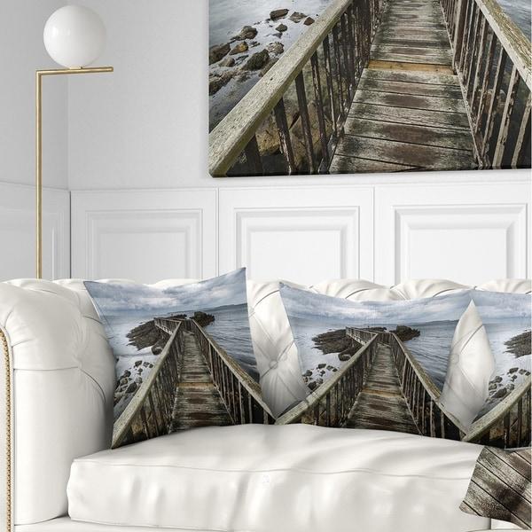 Designart 'Wooden Pier on North Irish Coastline' Sea Bridge Throw Pillow