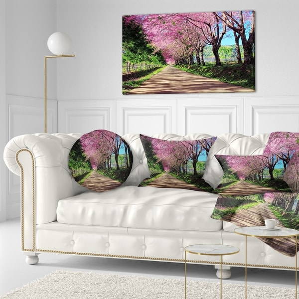 Designart 'Cherry Blossom Pathway in Chiang Mai' Landscape Printed Throw Pillow
