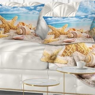 Designart 'Starfish and Seashells on Beach' Seashore Photo Throw Pillow