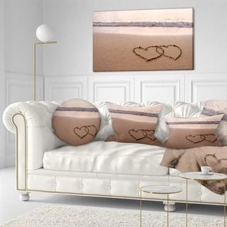 Designart 'Two Hearts Drawn on the Beach' Seascape Throw Pillow