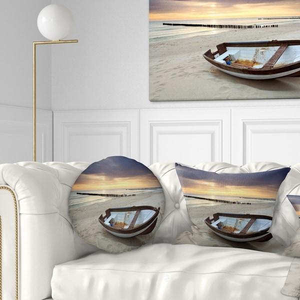 Designart 'Boat on Beautiful Sunrise Seashore' Beach Throw Pillow