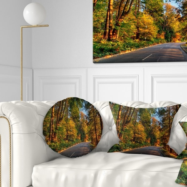 Designart 'Road through Lit up Fall Forest' Landscape Printed Throw Pillow