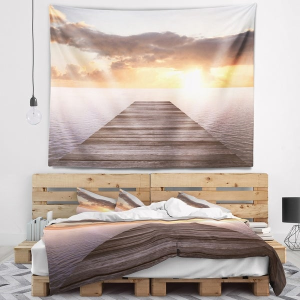 Designart 'Yellow Sea and Brown Pier' Seascape Wall Tapestry