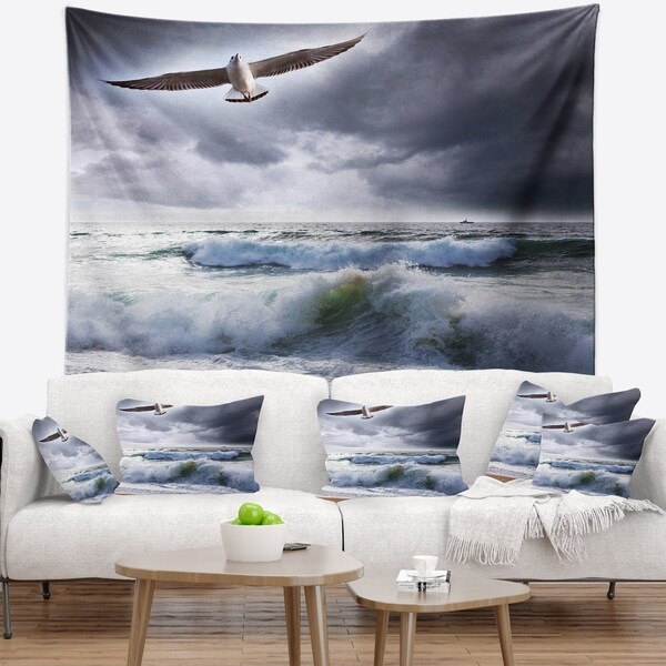 Designart 'Large Seagull over Stormy Waves' Modern Beach Wall Tapestry