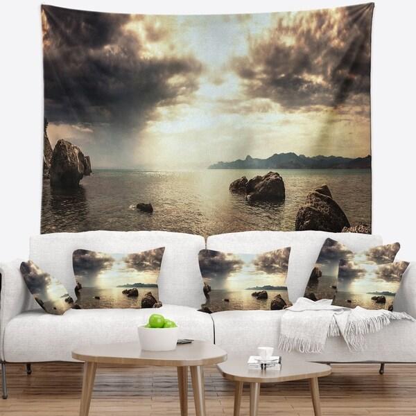 Designart 'Rocky Seashore under Clouds Panorama' Modern Beach Wall Tapestry