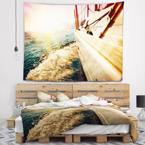 Designart 'Huge Yacht Sailing Against Sunset' Pier Wall Tapestry