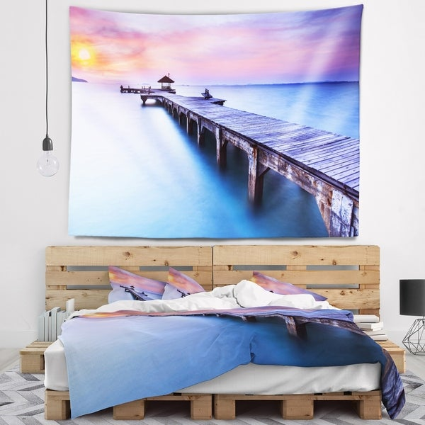 Designart 'Beach with Blue Waters and Wood Bridge' Pier Seascape Wall Tapestry