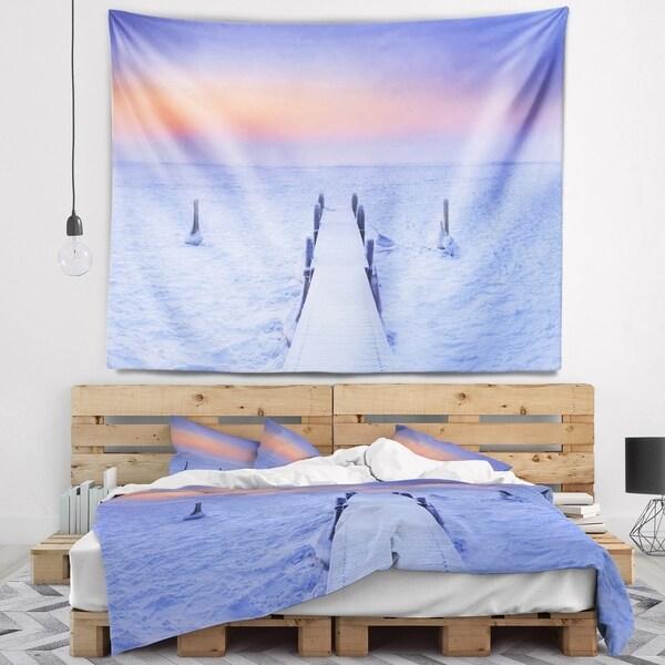 Designart 'Jetty in Frozen Lake Netherlands' Wooden Sea Bridge Wall Tapestry