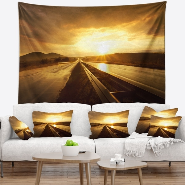 Designart 'Wet After Rain Road at Sunset' Landscape Wall Tapestry
