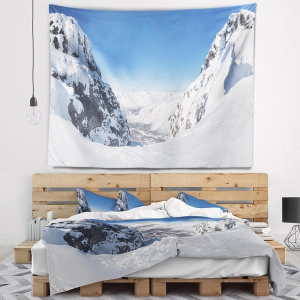 Designart 'Pass in the Northern Winter Hills' Landscape Wall Tapestry