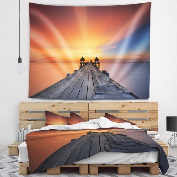 Designart 'Wooden Bridge under Illuminated Sky' Pier Seascape Wall Tapestry