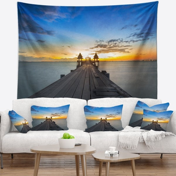 Designart 'Long Wood Pier Leading to Colorful Sea' Sea Bridge Wall Tapestry