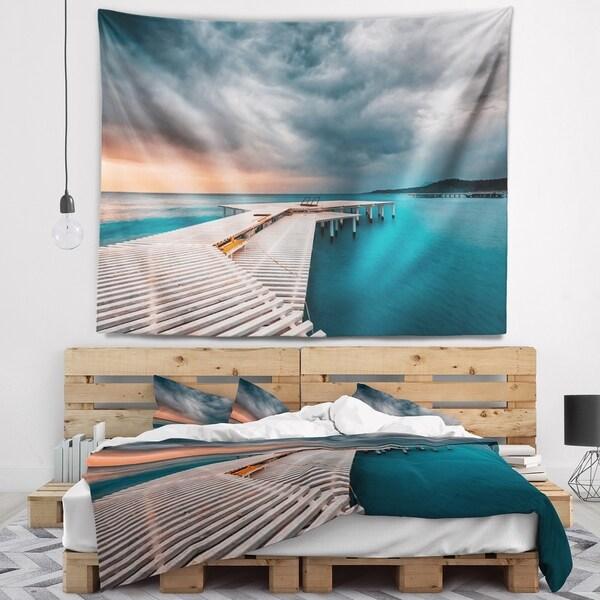 Designart 'Pier in Ocean in Cloudy Day' Seashore Photo Wall Tapestry