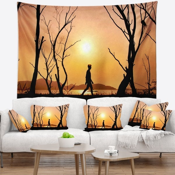 Designart 'Man Walking Alone in Evening' Landscape Photography Wall Tapestry